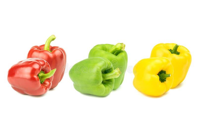 Κόκκινο κιτρινοπράσινο λαχανικό πιπεριών κουδουνιών που απομονώνεται σε ένα λευκό στοκ εικόνες