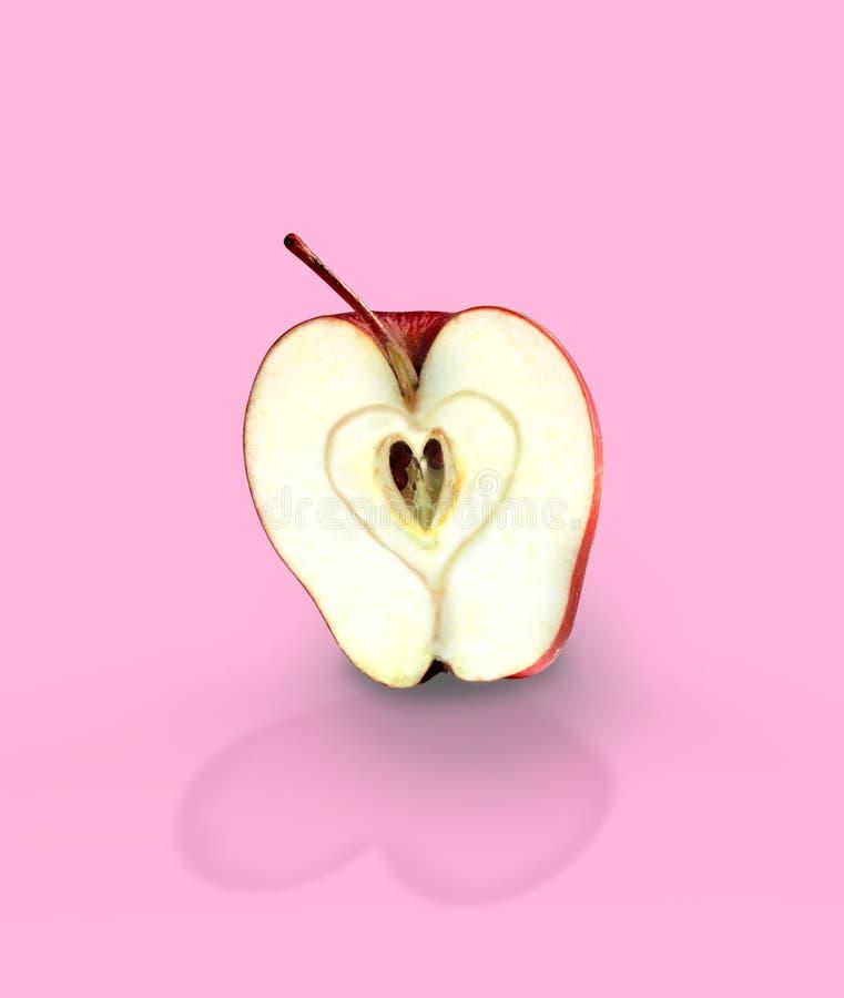 Κόκκινο μήλο με τη σκιά καρδιών Αγάπη της Apple στοκ φωτογραφία