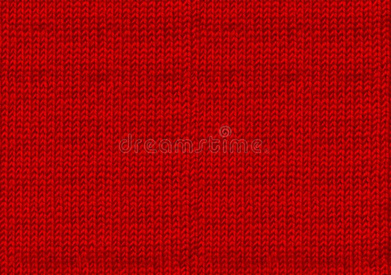 Κόκκινο πλεκτό χριστουγεννιάτικο φόντο Η ατμόσφαιρα ενός θερμού πουλόβερ Ταπετσαρία για το νέο έτος Υφή του μαλλιού ή του ακρυλικ στοκ εικόνες