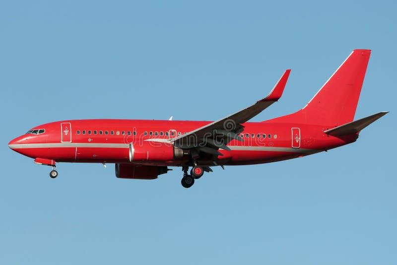 Κόκκινο στενό αεριωθούμενο αεροπλάνο σωμάτων στοκ φωτογραφίες με δικαίωμα ελεύθερης χρήσης