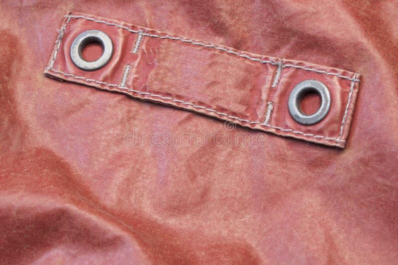 Κόκκινο σύγχρονο τεμάχιο σακακιών δέρματος με την κενή ετικέτα στοκ φωτογραφία