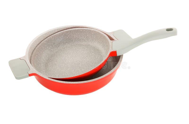 Κόκκινο τηγάνι κεραμικός-μετάλλων στοκ εικόνες