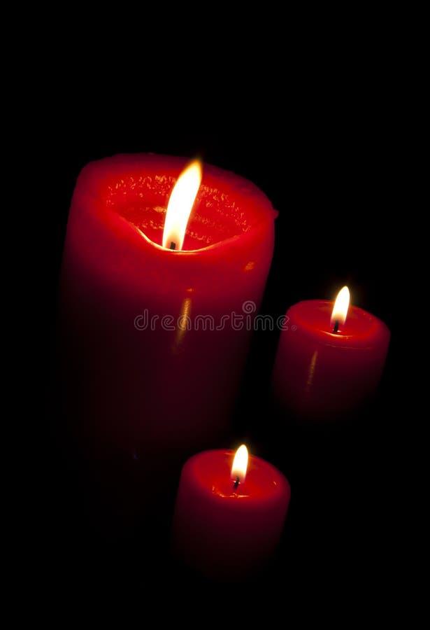 κόκκινο τρία κεριών στοκ φωτογραφίες