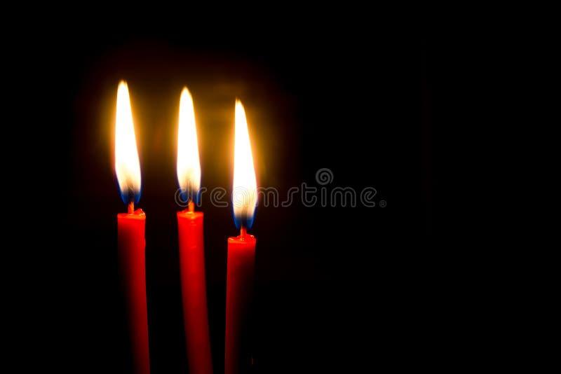 κόκκινο τρία κεριών στοκ φωτογραφία με δικαίωμα ελεύθερης χρήσης