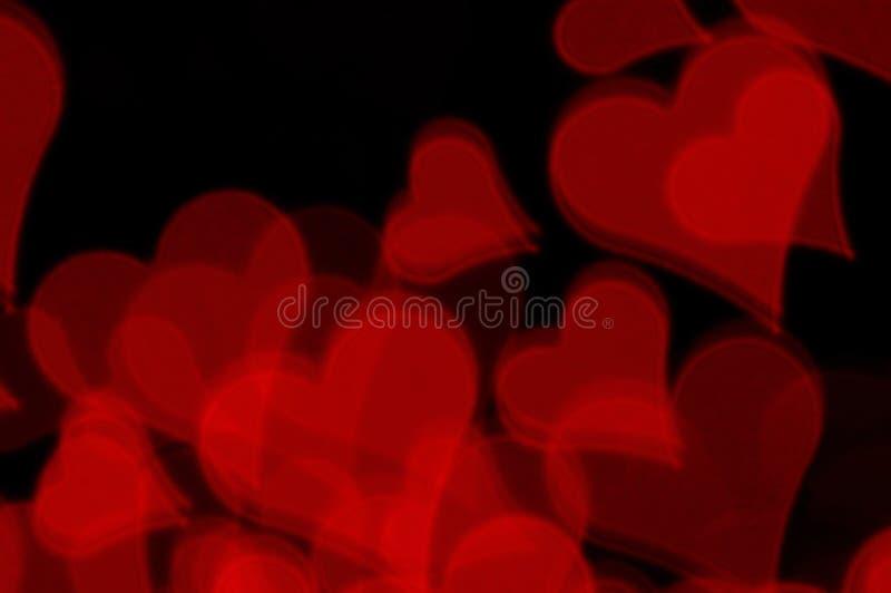 Κόκκινο υπόβαθρο αγάπης καρδιών στοκ φωτογραφίες με δικαίωμα ελεύθερης χρήσης