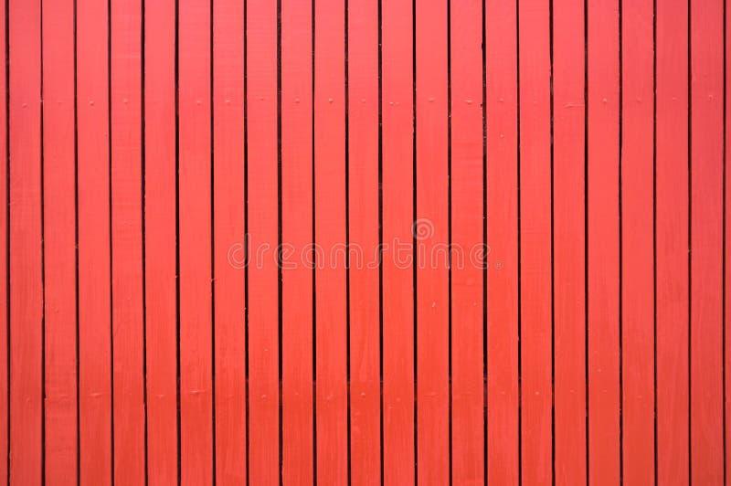 Κόκκινο χρωματισμένο ξύλινο υπόβαθρο σύστασης φρακτών στοκ φωτογραφία