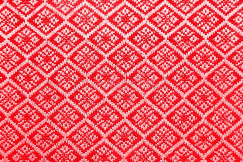 Κόκκινο ύφασμα σχεδίων διαμαντιών απεικόνιση αποθεμάτων
