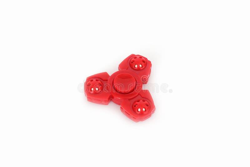 Κόκκινο spiner σε ένα άσπρο υπόβαθρο στοκ φωτογραφία με δικαίωμα ελεύθερης χρήσης