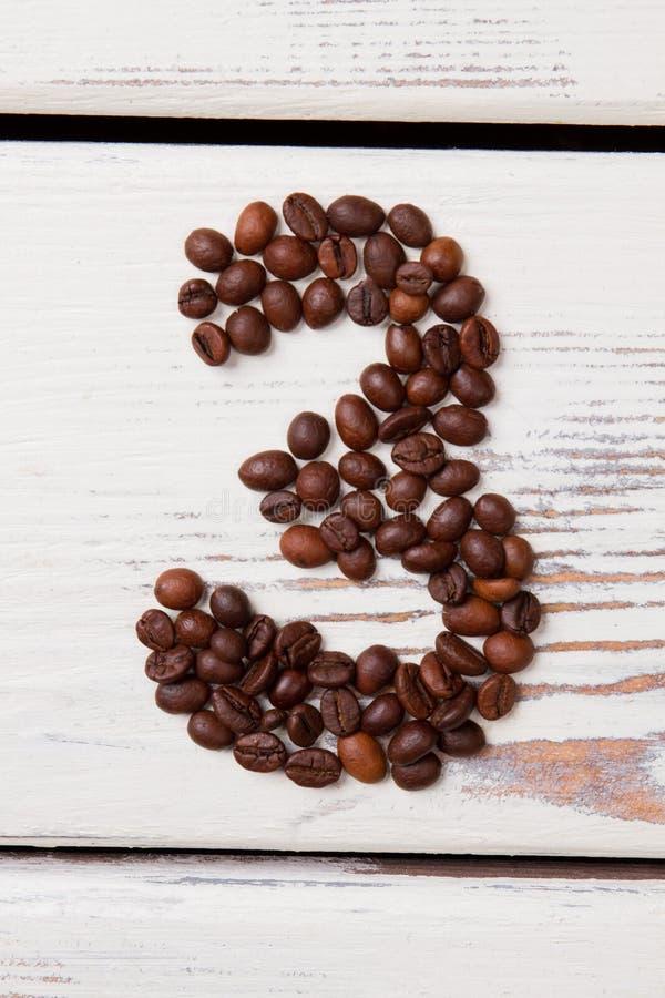 Κόκκοι καφέ υπό μορφή αριθμού 3 στοκ φωτογραφίες