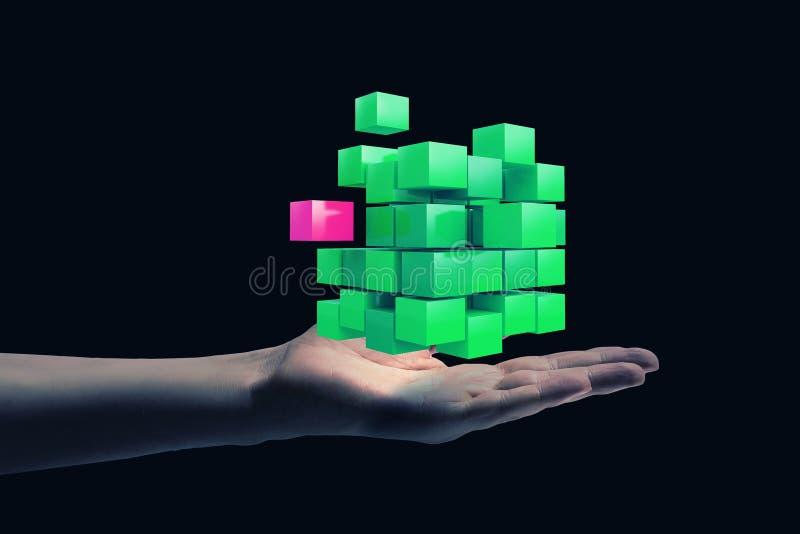 Κύβος στο αρσενικό χέρι Μικτά μέσα στοκ φωτογραφία με δικαίωμα ελεύθερης χρήσης