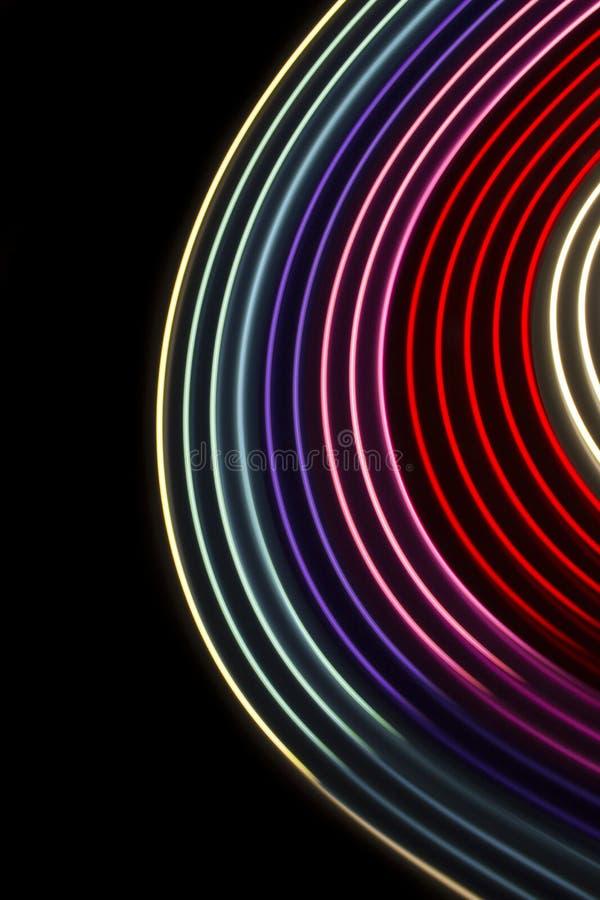 Κύκλοι με πολλά χρώματα σε μαύρο φόντο στοκ εικόνες