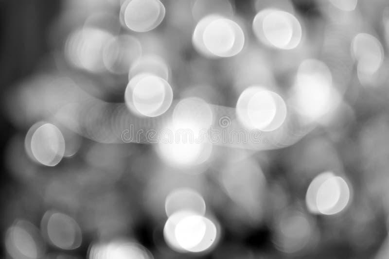 Κύκλοι Bokeh για το υπόβαθρο Χριστουγέννων Θαμπάδα του φωτεινού φωτός Αφηρημένη διακόσμηση ή σχέδιο του θολωμένου χρυσού χρώματος στοκ φωτογραφία με δικαίωμα ελεύθερης χρήσης