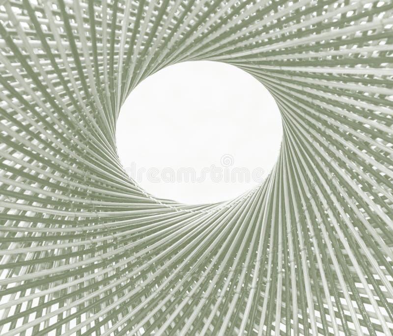 Κύκλος και τρύπα σχεδίων ύφανσης στη μέση του υποβάθρου μπαμπού στοκ εικόνα