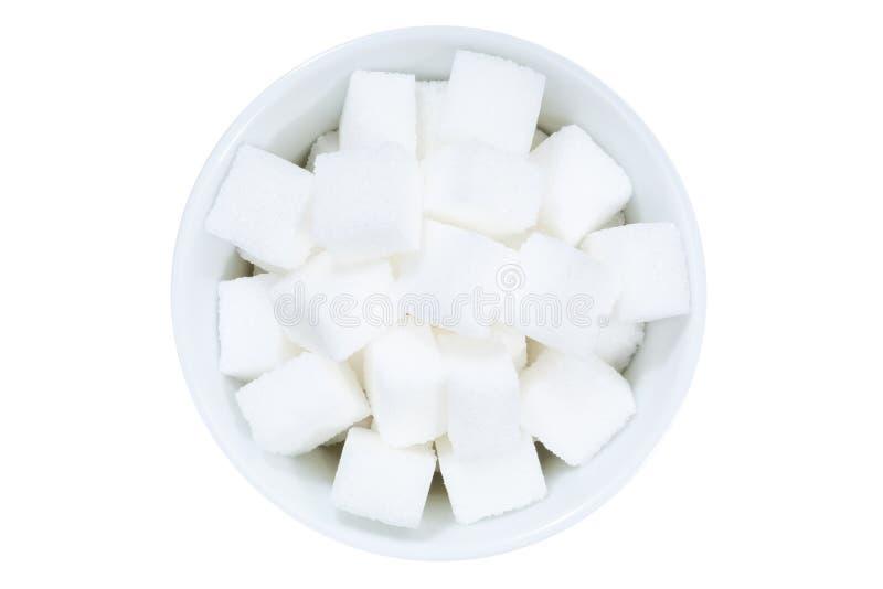 Κύπελλο ζάχαρης κομματιών άνωθεν που απομονώνεται στο λευκό στοκ εικόνες