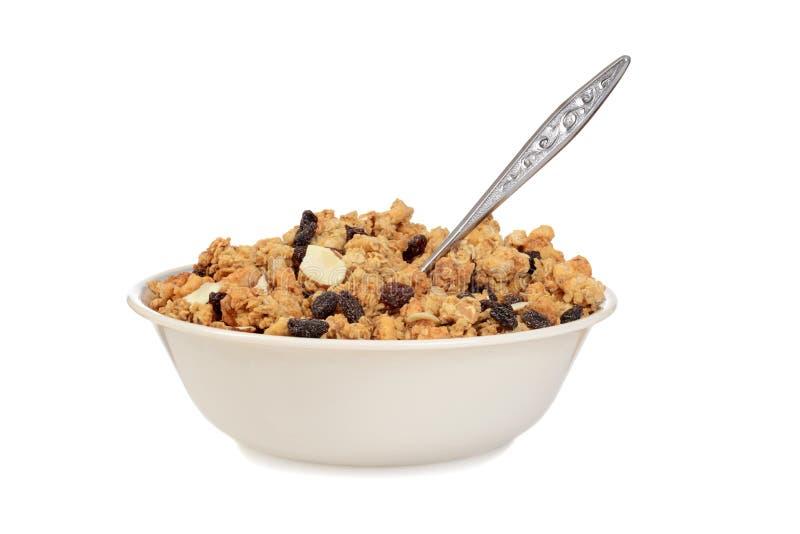Κύπελλο των δημητριακών αμυγδάλων σταφίδων granola με ένα κουτάλι στοκ φωτογραφίες με δικαίωμα ελεύθερης χρήσης