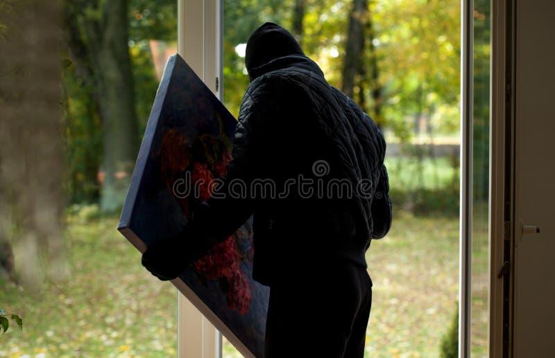 Κλέφτης με τη ζωγραφική στοκ εικόνα με δικαίωμα ελεύθερης χρήσης