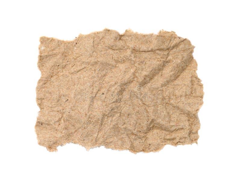 Κλείστε επάνω ενός άσπρου σχισμένου κομματιού του χαρτί ειδήσεων επάνω για το άσπρο backg στοκ φωτογραφία με δικαίωμα ελεύθερης χρήσης