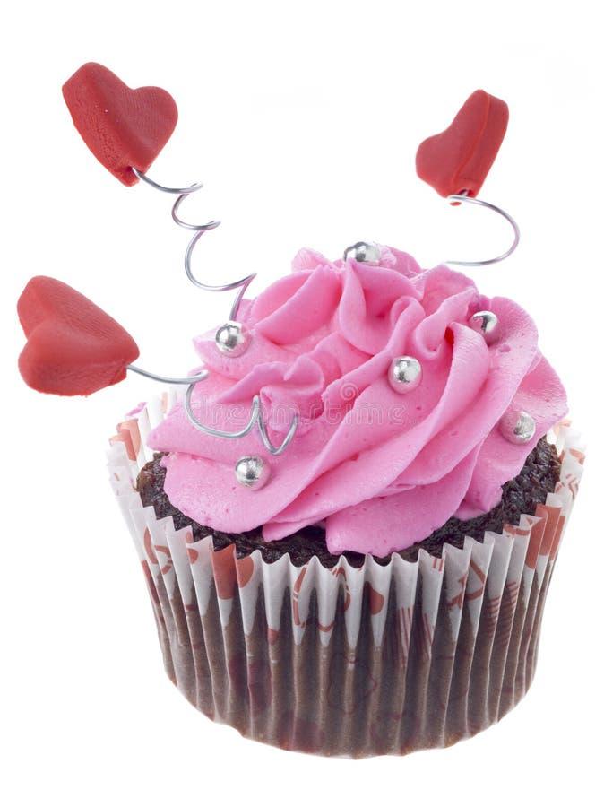 Download κλείστε επάνω την εικόνα της σοκολάτας Cupcake με τη ρόδινες τήξη και την καρδιά SH Στοκ Εικόνες - εικόνα από διακοσμήσεις, flavorful: 62718260