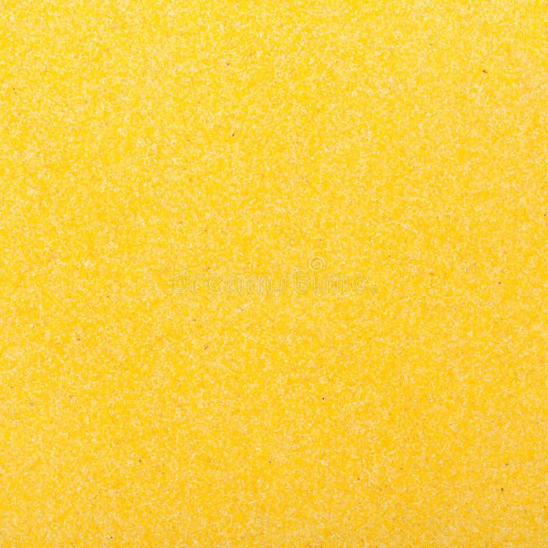 Κλείστε επάνω τη σύσταση υποβάθρου τροφίμων γεύματος κίτρινου αραβόσιτου. Διατροφή διατροφής. στοκ φωτογραφία