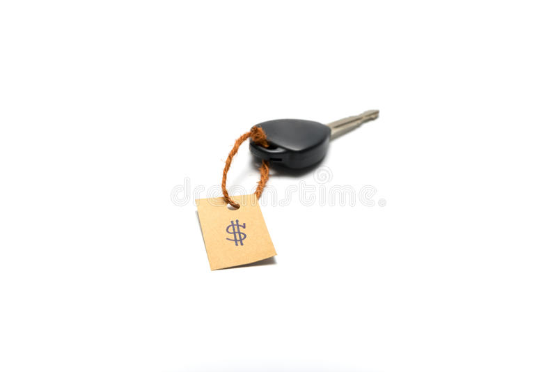 Κλειδί αυτοκινήτων με τη τιμή στοκ φωτογραφία