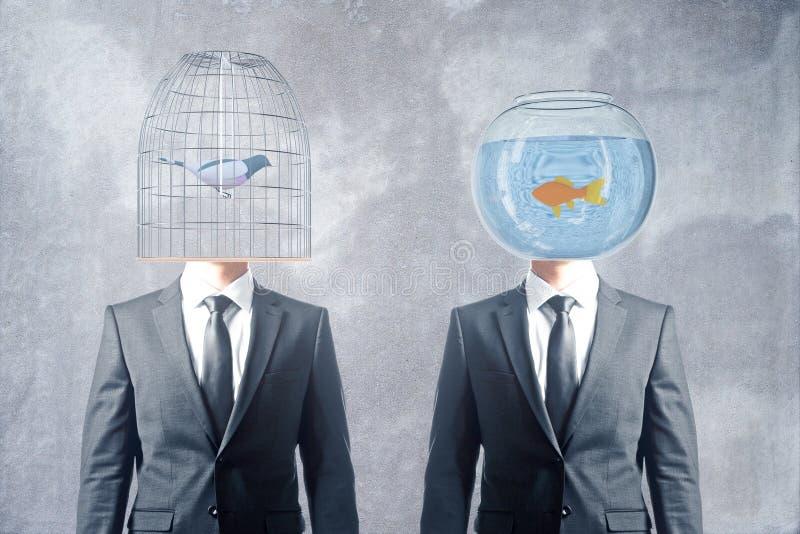 Κλουβί και fishbowl κεφάλια στοκ φωτογραφία
