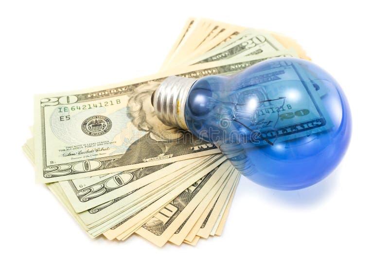 Λάμπα φωτός με τους λογαριασμούς δολαρίων στο άσπρο υπόβαθρο στοκ εικόνα με δικαίωμα ελεύθερης χρήσης