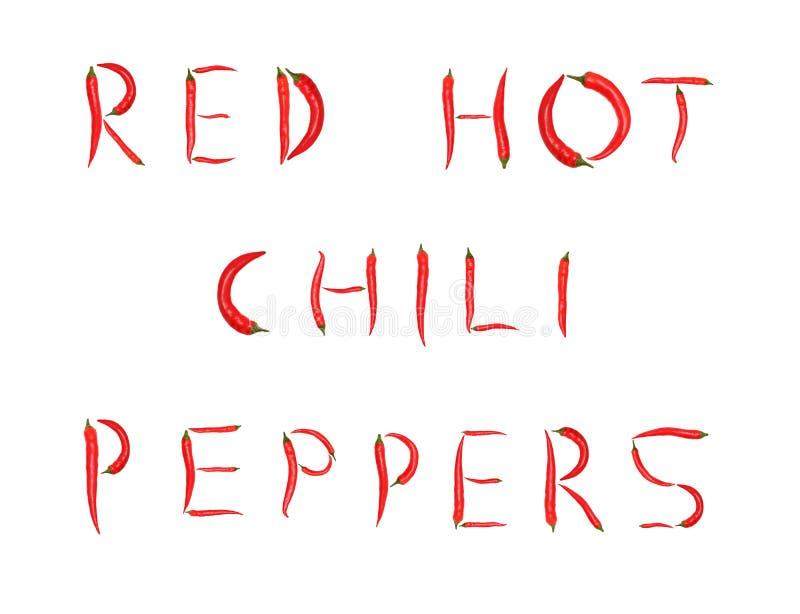Λέξεις που γίνονται τα κόκκινα πιπέρια τσίλι (που απομονώνονται από) στοκ φωτογραφία