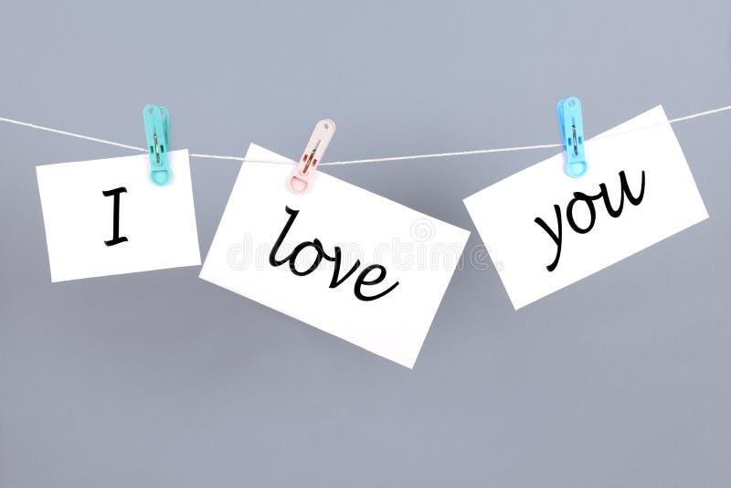 Λέξεις σ' αγαπώ στη Λευκή Βίβλο και ένωση στο σκοινί στοκ εικόνες