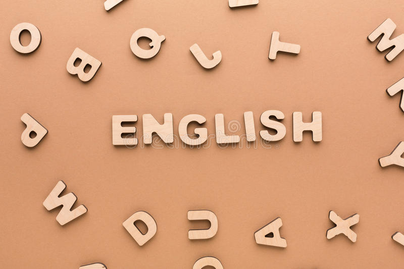 Λέξη αγγλικά στο μπεζ υπόβαθρο στοκ εικόνες