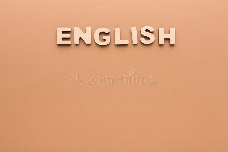 Λέξη αγγλικά στο μπεζ υπόβαθρο στοκ εικόνες με δικαίωμα ελεύθερης χρήσης