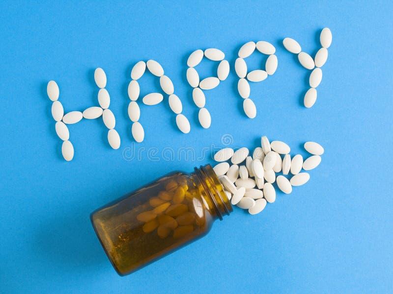Λέξη ευτυχής και χάπια βάζων στοκ φωτογραφίες με δικαίωμα ελεύθερης χρήσης