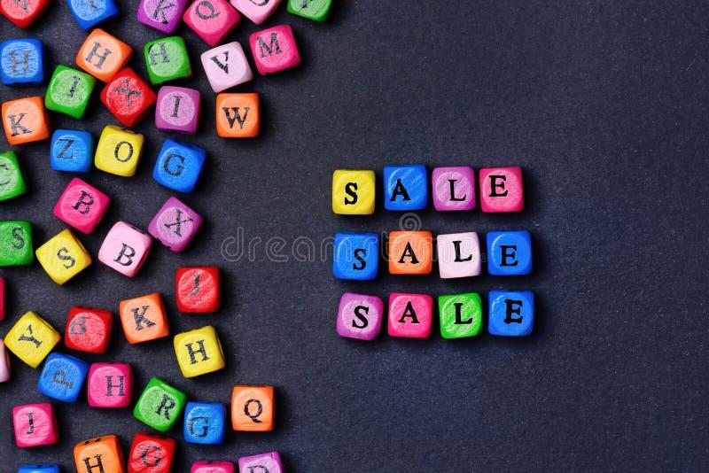 Λέξη πώλησης στο μαύρο υπόβαθρο στοκ φωτογραφία με δικαίωμα ελεύθερης χρήσης