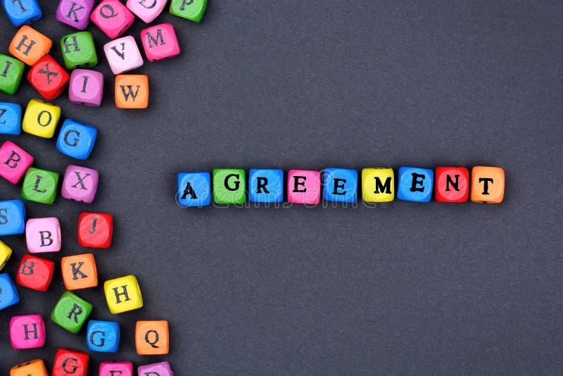 Λέξη συμφωνίας στο μαύρο υπόβαθρο στοκ εικόνες
