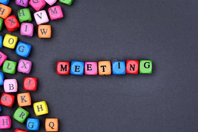 Λέξη συνεδρίασης στο μαύρο υπόβαθρο στοκ φωτογραφία