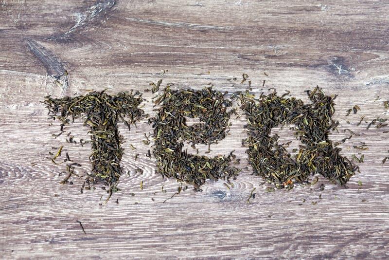 Λέξη τσαγιού φιαγμένη από πράσινα φύλλα τσαγιού στοκ εικόνες με δικαίωμα ελεύθερης χρήσης