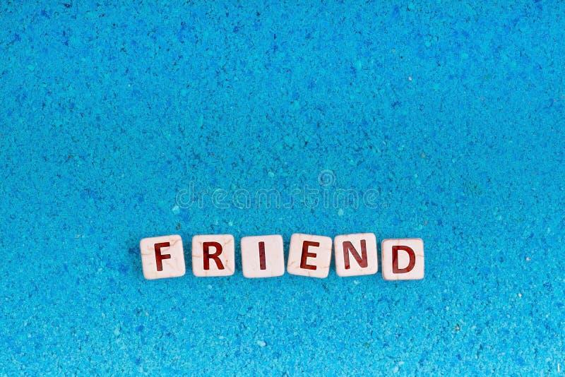 Λέξη φίλων στην πέτρα στοκ φωτογραφίες