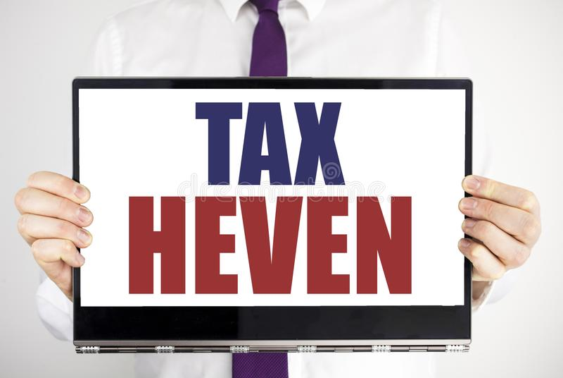 Λέξη, φόρος Heven γραψίματος Η επιχειρησιακή έννοια για τη φορολογία κέρδους που γράφτηκε στην εκμετάλλευση lap-top ταμπλετών από στοκ φωτογραφίες με δικαίωμα ελεύθερης χρήσης