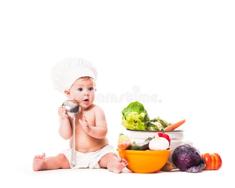 Λίγος αρχιμάγειρας μαγειρεύει στοκ φωτογραφία