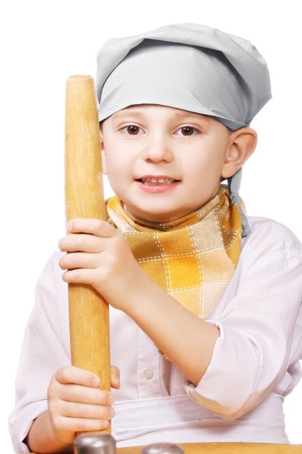 Λίγος μάγειρας με την κυλώντας καρφίτσα στοκ φωτογραφία με δικαίωμα ελεύθερης χρήσης