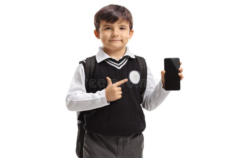 Λίγος μαθητής που κρατά ένα τηλέφωνο και μια υπόδειξη στοκ φωτογραφία με δικαίωμα ελεύθερης χρήσης