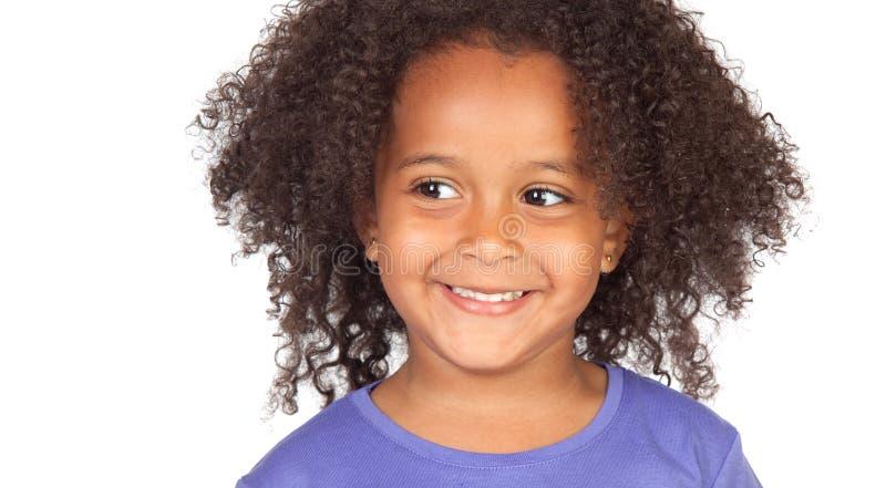 Λίγο αφρικανικό κορίτσι με μια όμορφη έκφραση στοκ φωτογραφία