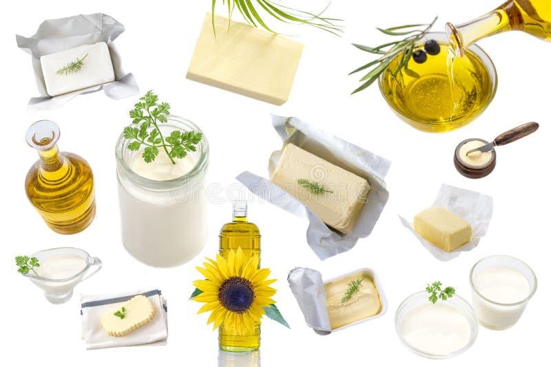 Λίπη και έλαιο τροφίμων: σύνολο γαλακτοκομικού προϊόντος και ελαίου και ζωικών λιπών σε ένα άσπρο υπόβαθρο στοκ φωτογραφία