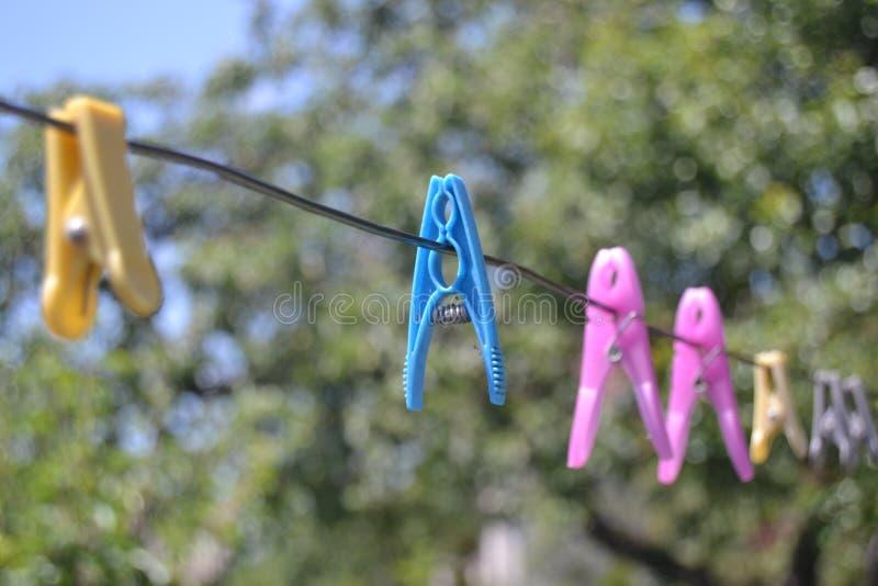 Λαβίδες πλυντηρίων στοκ φωτογραφίες