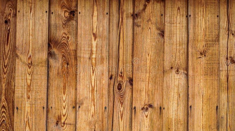 Λαδωμένος φράκτης σανίδων πεύκων Οριζόντια ξύλινη σύσταση στοκ φωτογραφίες