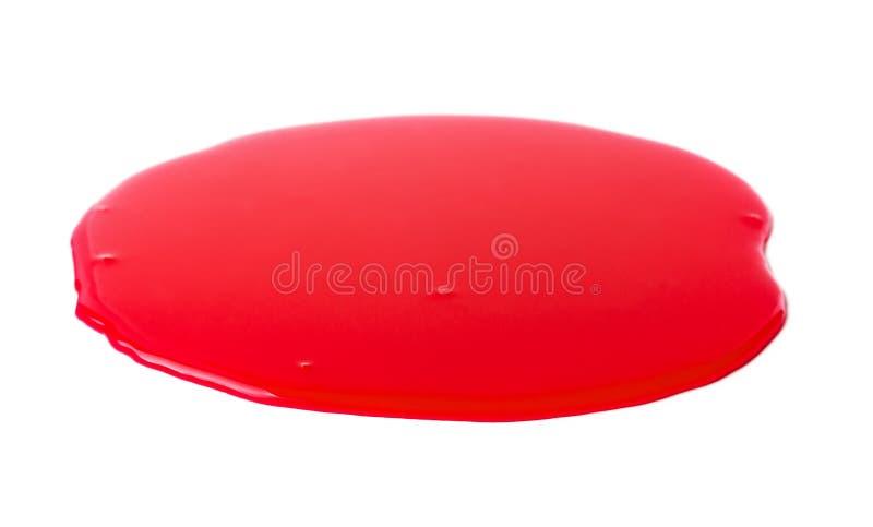 Λακκούβα ενός κόκκινου χυσίματος χρωμάτων στοκ εικόνα με δικαίωμα ελεύθερης χρήσης