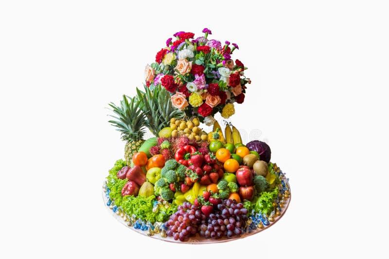 Λαχανικά, λουλούδια και διάφορα είδη φρούτων στοκ εικόνες