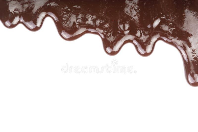 Λειωμένο στάλαγμα σοκολάτας που απομονώνεται στο άσπρο υπόβαθρο στοκ εικόνες