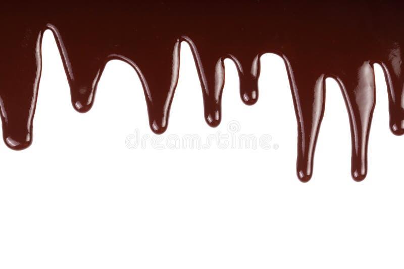 Λειωμένο στάλαγμα σοκολάτας που απομονώνεται στο άσπρο υπόβαθρο στοκ φωτογραφία