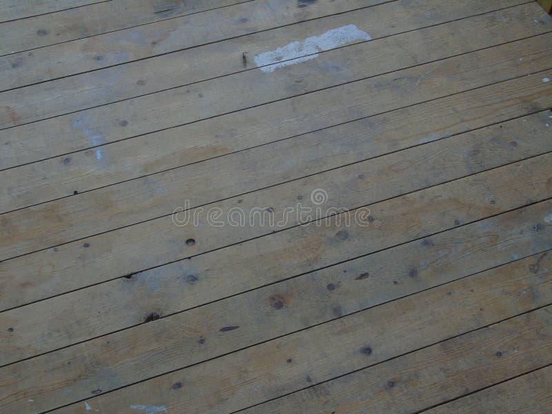 Λεκιασμένα χρώμα floorboards γλωσσών και αυλακιού στοκ φωτογραφία