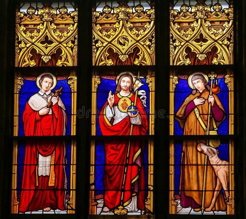 Λεκιασμένο γυαλί - Ιησούς Χριστός, Άγιος Roch και Άγιος Charles Borro στοκ εικόνες